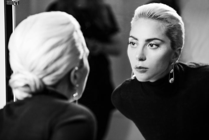 Lady Gaga behind the scenes of the Tiffany & Co. Legendary Style campaign shoot Product: Tiffany City HardWear triple drop earrings in 18k yellow gold Photo Credit: Hanna Besirevic