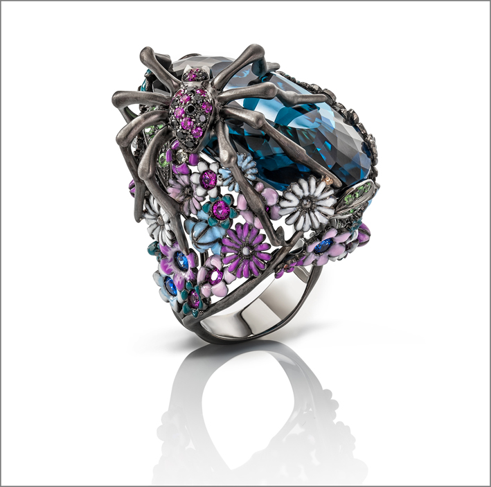 Black gold ring with 62 carat blue topaz stone, sapphires, citrine, rubies, amethyst, black spinel and natural green garnet