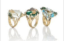 Yellow gold ring with prasiolite and white diamonds. Yellow god ring with emerald and rock crystal doublet and brown and white diamonds.  Yellow gold ring with blue topaz, natural green garnet and white diamonds