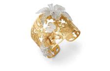 Bracciale Misis Marisol. Bracciale in argento placcato oro 18 kt e argentato con orchidee in  filigrana e zirconi. Prezzo: 635 euro