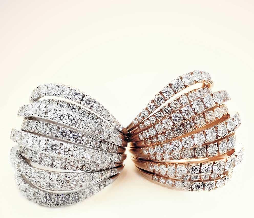 Anelli in oro bianco e rosa e diamanti