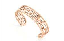 Bracciale in acciaio con rifiniture in PVD oro rosa, cristalli colorati. Prezzo: 109 euro