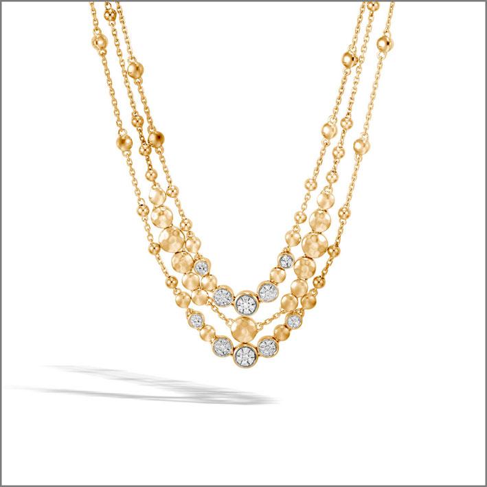 Collana multi filo in oro martellato e diamanti