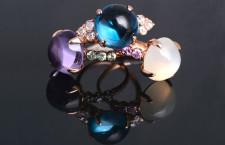 Anelli in oro rosa 18 kt con cabochon topazio e diamanti taglio rosecut, ametista viola e zaffiri viola, pietra di luna grigia e diamanti brown