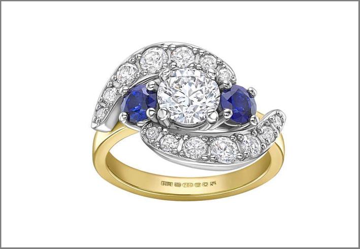 Anello dal disegno vintage con diamanti e zaffiri blu