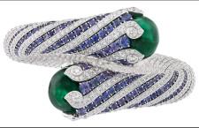 Bracciale Twist émeraude.  Oro bianco, brillanti, zaffiri viola rotondi, 2 cabochon di smeraldo di 19,80 e 21,48 carati (Colombia)