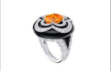 Anello con granato mandarino, onice, diamanti