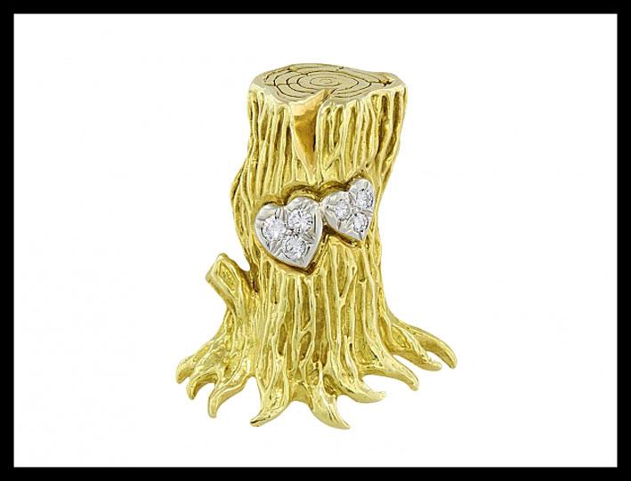 Spilla a forma di albero in oro e diamanti. Prezzo: 5450 dollari
