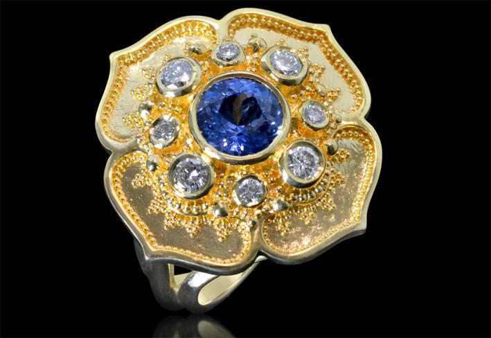 Anello a forma di fiore con zaffiro blu e diamanti