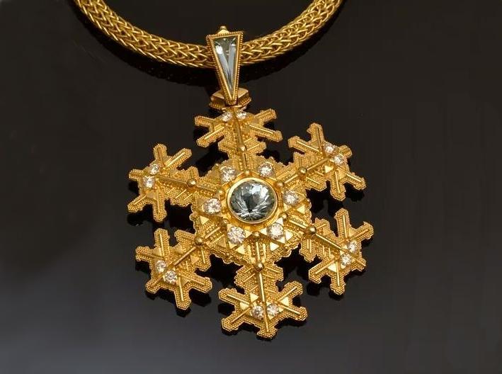 Medaglione in oro a forma di fiocco di neve