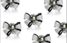 Spilla a fiocco con diamanti bianchi e neri