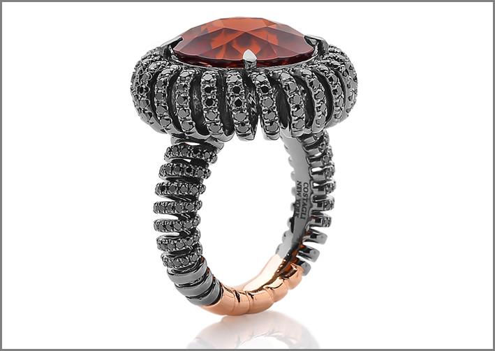 Anello in oro bianco con spirale di diamanti neri
