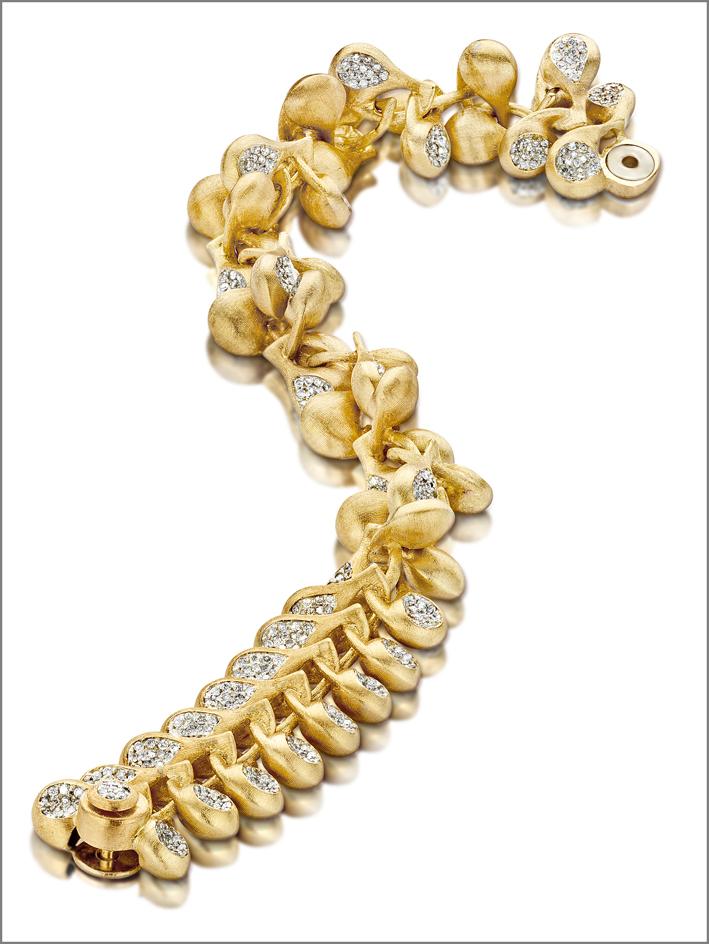 Trasformista, bracciale convertibile in oro 18kt e diamanti. Inciso manualmente utilizzando un bulino