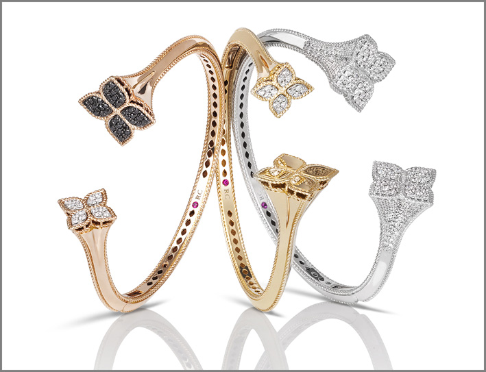 Cuffs in rose, yellow and white gold with black and white diamonds