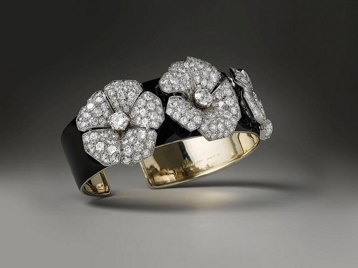 Bracciale di Cartier, oro, lacca nera, diamanti. Circa 1930