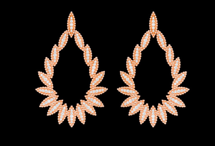 Orecchini in oro rosa e diamanti della collezione Luz di Carla Amorim