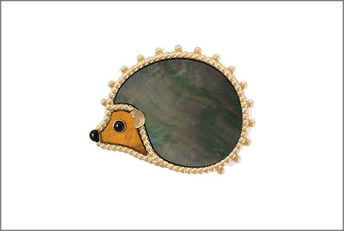 Riccio, oro giallo, madreperla grigia, occhio di tigre, onice