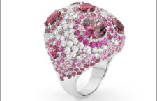 White gold ring with diamonds, pink sapphires and tourmaline