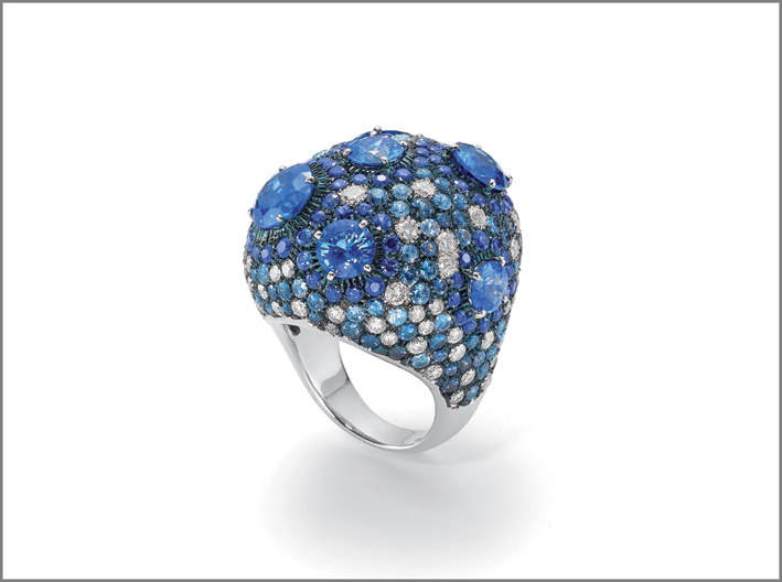 White gold ring with blue sapphires and diamonds