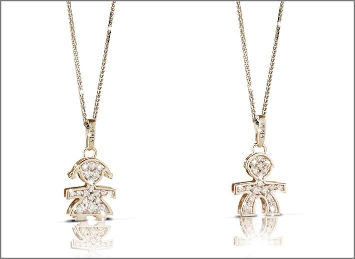 Silhouette maschietto femminuccia. Oro giallo/bianco/rosa, diamanti. Prezzo: 780 euro
