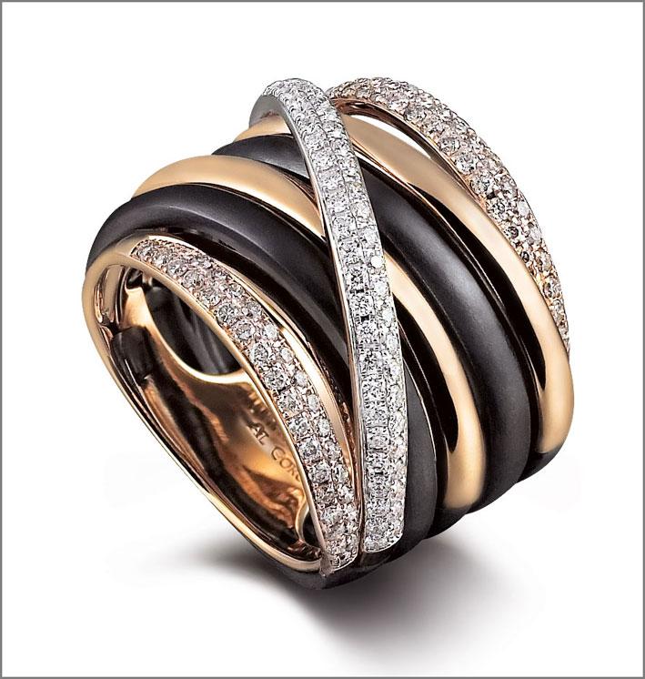 Anello in acciaio, oro rosa e diamanti