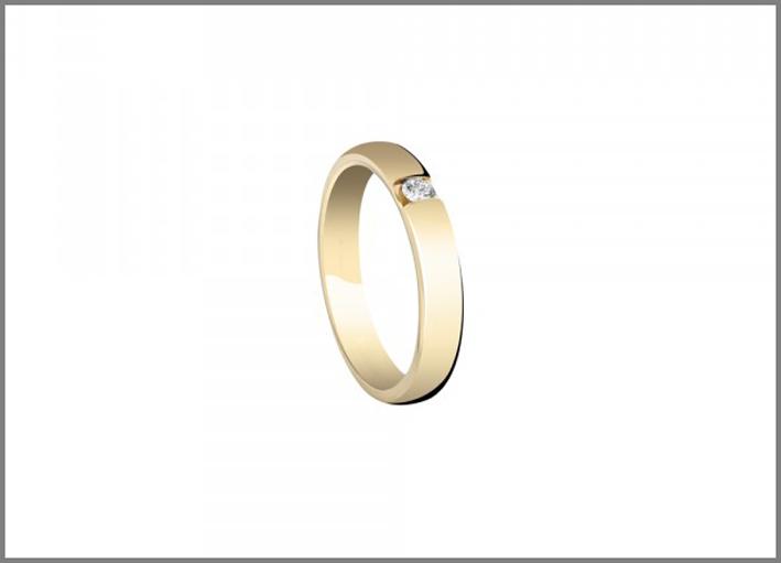 Collezione Veramore. Fede nuziale in oro giallo con diamante esterno. Prezzo: 1190 euro