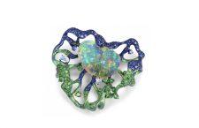 Spilla Lotus Wind in titanio con opale, pietra luna, tsavorite, zaffiro