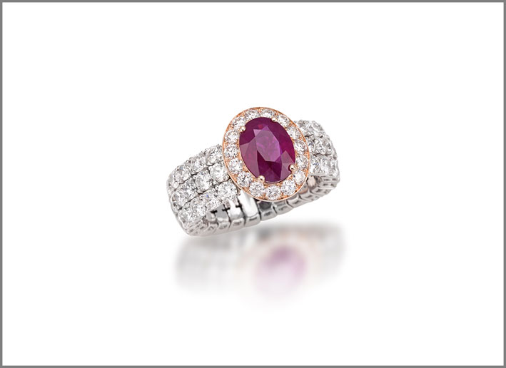 Oval ruby (1.18 ct) and diamond (3.29 ct) ring set in white gold
