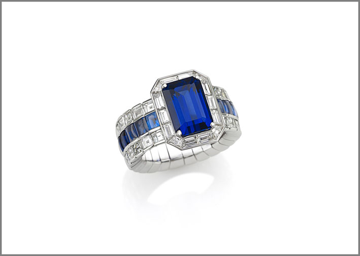 Cushion sapphire (5.55 ct) buff-topped sapphire (2.33 ct) and diamond (2.93 ct) ring set in white gold