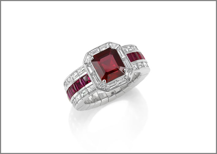 Octagonal ruby (3.01 ct) buff-topped rubie ( 1.26 ct) and diamond (2.17 ct) ring set in white gold