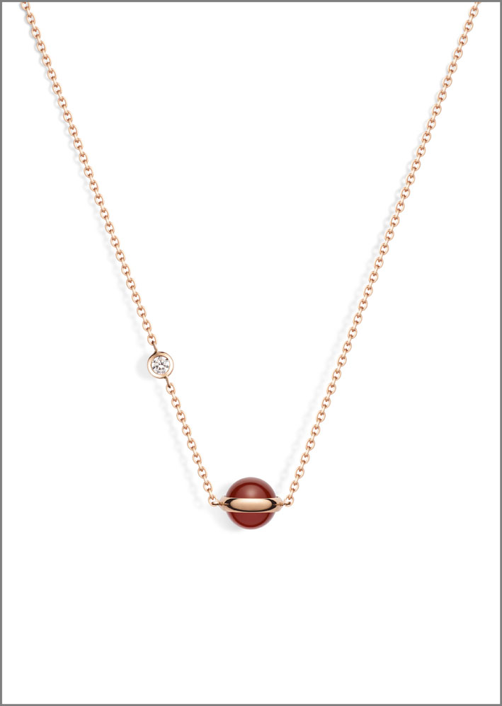 Ciondolo della collezione Possession con corniola, oro rosa 18 carati, con un diamante taglio brillante (circa 0,06 carati)