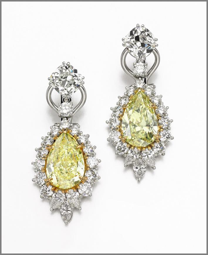 Pair of fancy intense yellow diamond pendent earrings