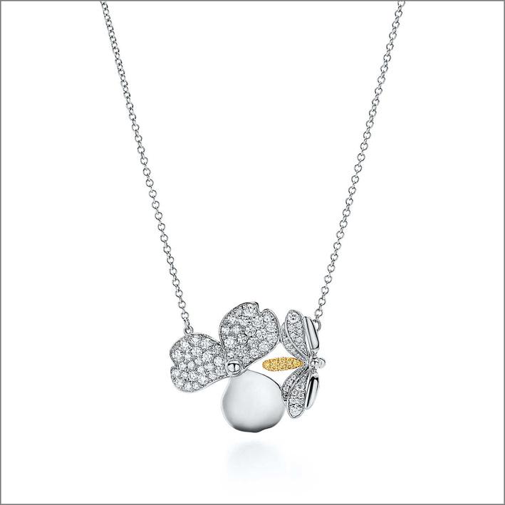 Collana in platino con diamanti bianchi brillanti e oro 18k, con un diamante giallo rotondo
