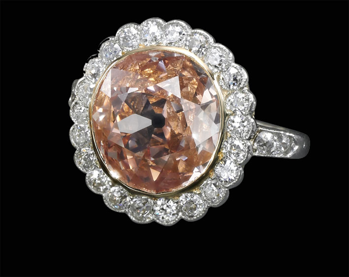 Anello con diamante fancy orange-pink