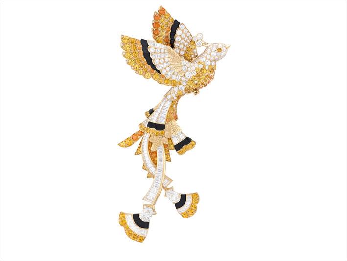 Oiseau d'or in zaffiri gialli, granati spessartine, onice e diamanti