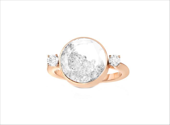 Anello in oro rosa con diamanti e zaffiri bianchi