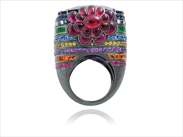 Ring 18 k gold 47.6 gr, 38 white & black diamonds 0.7 ct, 63 rubies 11.68 cts, 245 fancy sapphires 8.45 cts, size 55