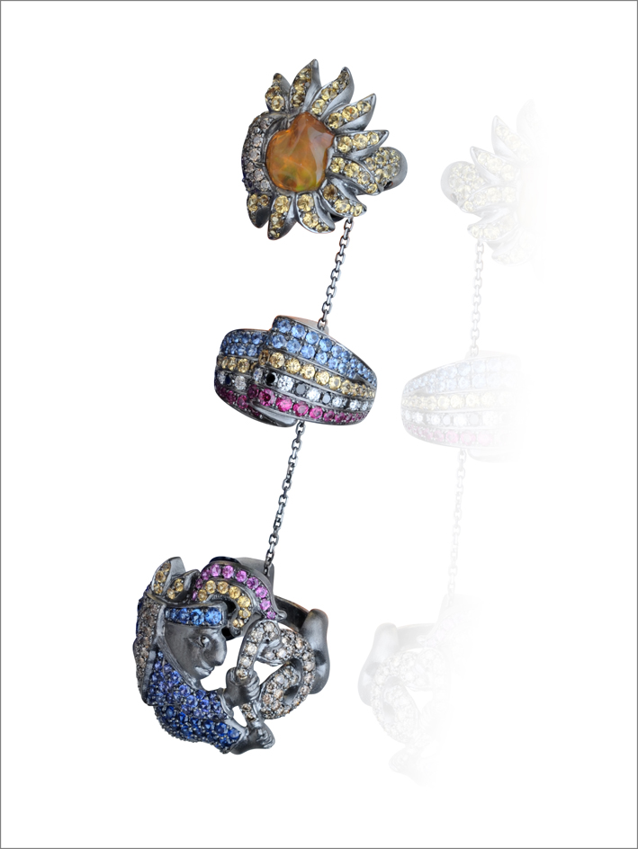 Ring harem, gold 18K, 1 opal 0,40grs, 239 fancy sapphires 2,63cts, 71 sapphires 1,05cts, 21 rubies 0,39cts, 84 brown diamonds 0,99cts, 12 black diamonds 0,18cts, 10 diamonds 0,16cts