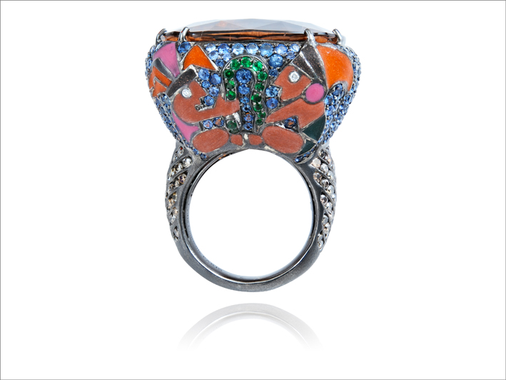 Ring 18 k gold 25.35 gr, 4, diamonds 0.03 ct, 94 brown diamonds 1.56 ct, 263 fancy sapphires 4.11 cts, 14 tsavorites 0.03 gr