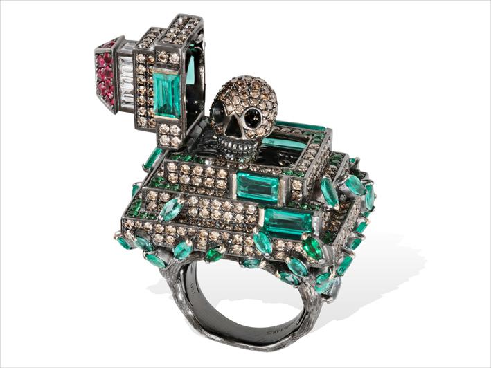Ring 18 k gold 41.87 grs, 14 white diamonds 0.44 ct, 487 brown diamonds 6.84 cts, 16 rubys 0.68 ct, 54 tsavorites 0.22 gr, 4 aquamarine 0.24 gr, 36 emeralds 4.05 ct, 5 turmalins 0.62 gr