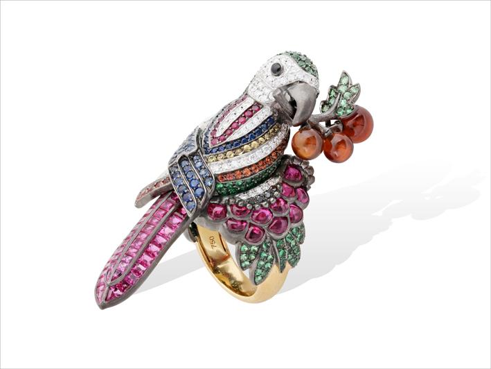 Ring, 19 k gold 26.73 grs, 85 diamonds 0.78 ct, 9 brown diamonds 0.08 ct, 76 rubies 10.23 cts, 106 fancy sapphires 1.79 ct, 186 tsavorites 0.54 gr, 3 grenats 1.02 gr