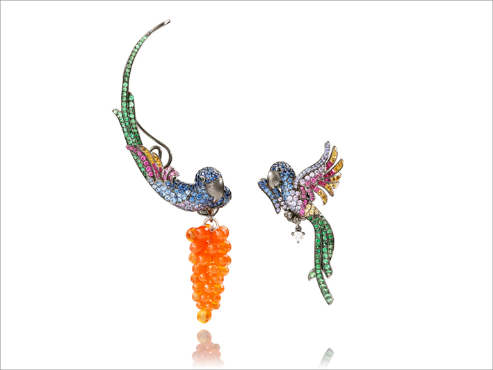 Earrings, 19 k gold 18.79 grs, 1 diamond 0.13 ct, 45 rubies 1.02 ct, 111 fancy sapphires 3.84 cts, 1 opal / 3.90 grs, 89 tsavorites 0.22 gr
