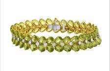 Bracciale in oro giallo, diamanti e peridoto