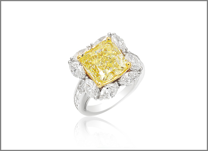 Cushion fancy yellow diamond (7.30 ct) and diamond (3.18 ct) ring set in white and yellow gold