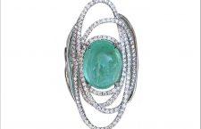 Uno dei pezzi storici della Maison: anello Orbis Lacteus in oro bianco diamanti e grande tormalina Paraiba