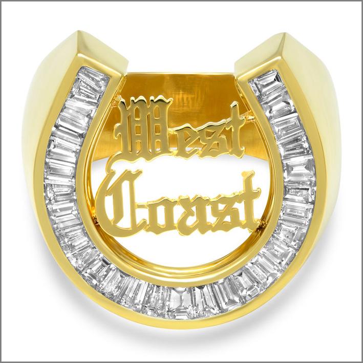 Anello a ferro di cavallo in oro 18 carati e diamanti baguette