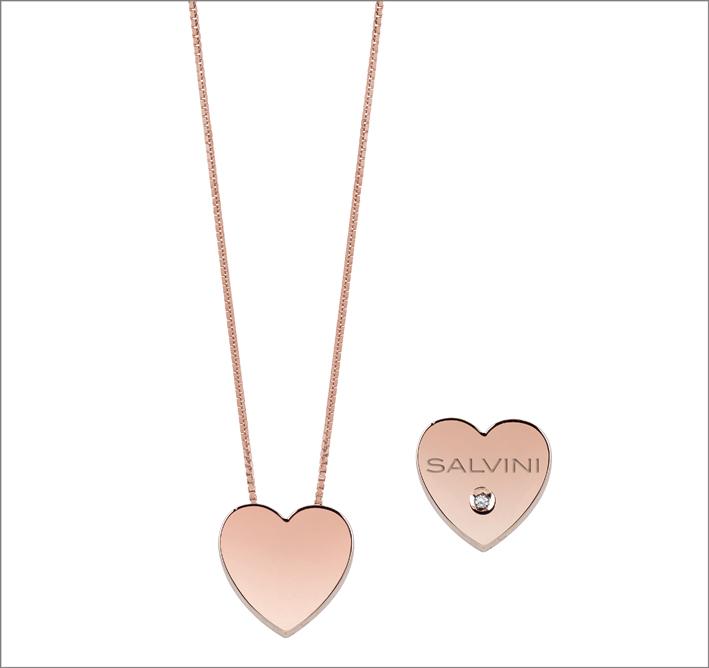 Collier in oro rosa con segno a forma di cuore, impreziosito da un dettaglio in diamante