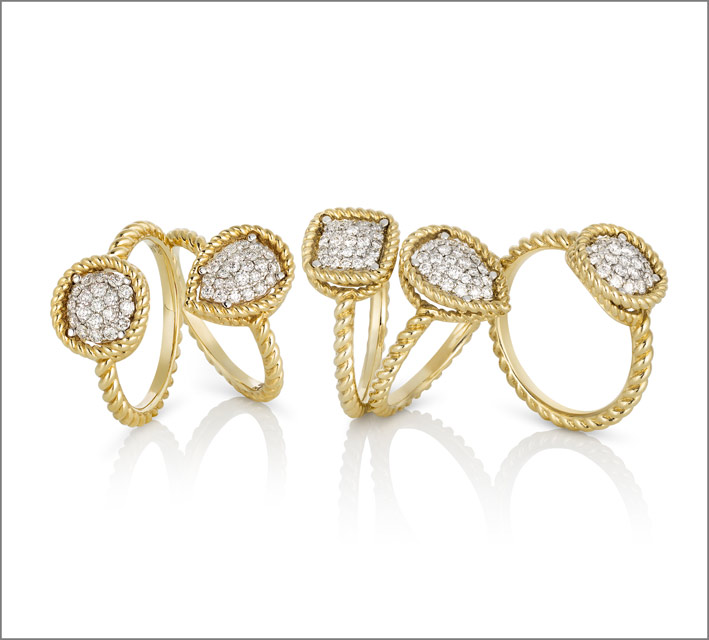 Yellow gold rings with colorless diamonds