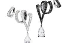 Chiaroscuro Gold Ribbons. Orecchini a forma di un nastro d'oro che si avvolge intorno all'orecchio, interamente rivestito di diamanti bianchi, con diamanti neri sul retro. Sull'orecchio opposto i diamanti neri prendono il sopravvento. Con diamanti pendenti taglio pera. Questi orecchini presentano una parte staccabile. La clip superiore, indipendente, può essere indossata con la parte inferiore per creare un earcuff