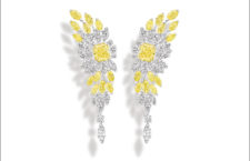 Golden Hour Earrings, yellow gold and platinum earrings set with 2 radiantcut fancy vivid yellow diamonds (approx. 3.10 cts and 3.05 cts), 24 marquise-cut yellow diamonds (approx. 5.52 cts), 26 marquise-cut diamonds (approx. 7.97 cts) and 12 brilliant-cut diamonds (approx. 1.14 cts). Unique creation